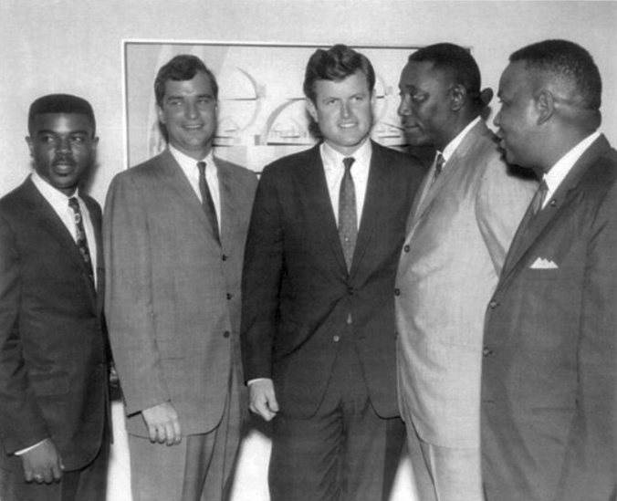 Standing, from left to right Cleveland Donald Jr., Hodding Carter, the editor of the Delta Democrat Times; Sen. Ted Kennedy; Charles Evers, brother and successor to slain NAACP Field Secretary Medgar Evers; and Aaron Henry, then state president of NAACP.